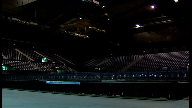 wembley arena re-opens after restoration; ext crowds wander about in front of newly refurbished wembley arena int empty seating and stage in new... - wembley arena stock videos & royalty-free footage