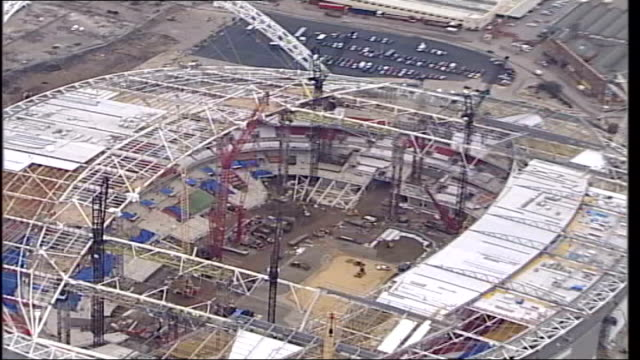 wembley arena re-opens after restoration; file / r21020611 england: london: wembley: ext air view wembley stadium under construction - wembley stadium stock videos & royalty-free footage