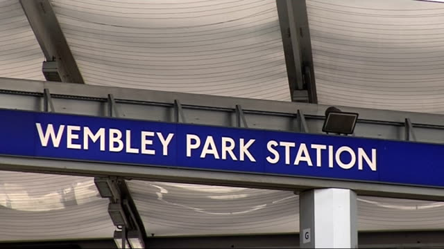 london wembley ext general exterior views of wembley park station and sign above entrance - wembley stock-videos und b-roll-filmmaterial