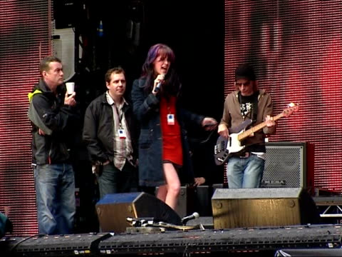 princess diana memorial concert: joss stone rehearsing; england: london: wembley: wembley stadium: ext / raining joss stone dancing about on stage at... - wembley stock videos & royalty-free footage