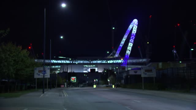 wembley stadium arch light tribute england london wembley stadium various wembley stadium arch illuminated in blue and white - wembley stock videos & royalty-free footage