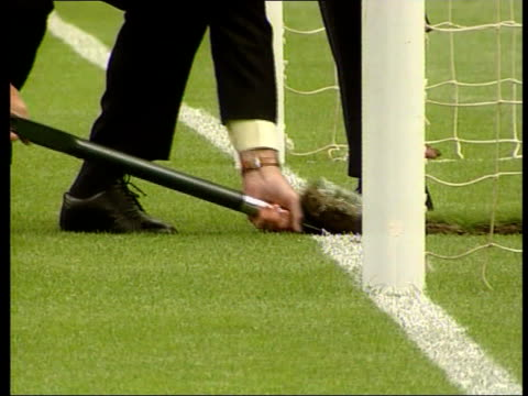 wembley stadium auction; lib sir geoff hurst digging up patch of turf turf lifted on shovel tilt up tx 20.5.2000/c4n - turf stock videos & royalty-free footage