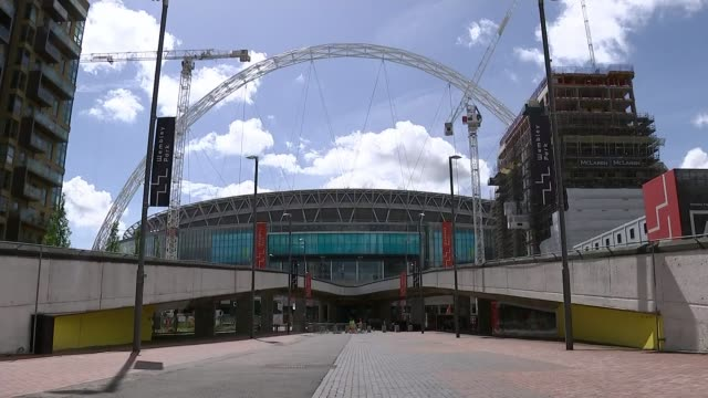 wembley stadium bid; wembley: ext gv wembley stadium - seen from wembley way/ london: calais campbell throwing ball at american football 'fanzone'... - wembley stadium stock videos & royalty-free footage