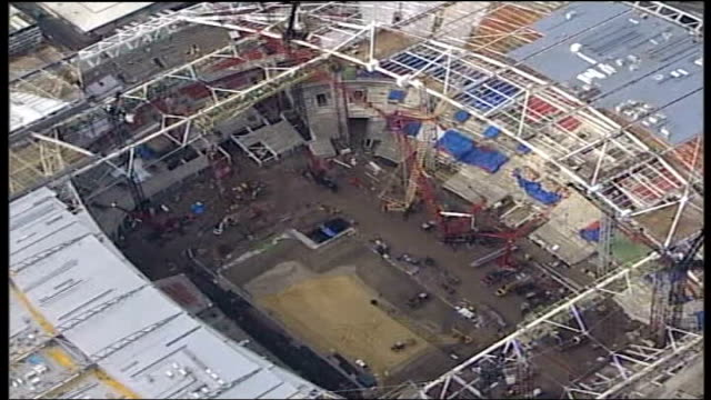 building site workers sent home after fifty tonne rafter accident; date unknown air view wembley stadium under construction - wembley stock videos & royalty-free footage