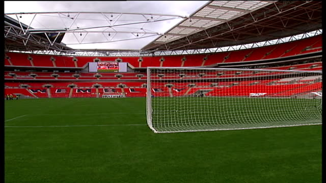wembley stadium construction nears completion; england: london: wembley stadium: int general views of interiors of stadium showing newly laid pitch... - wembley stadium stock videos & royalty-free footage