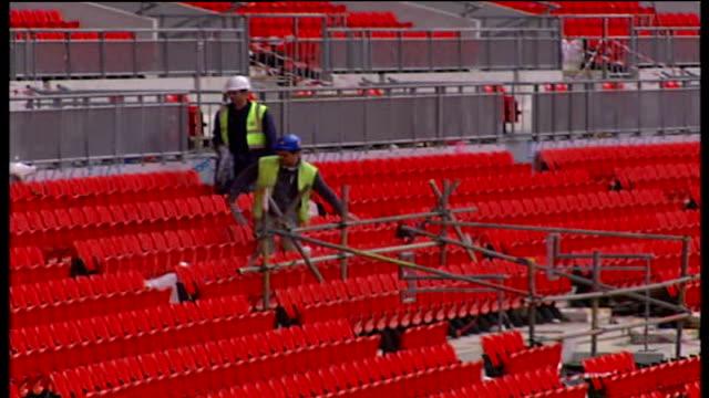 wembley stadium construction nears completion: stadium interior general views; england: london: wembley stadium: ext good general views of interiors... - wembley stock videos & royalty-free footage