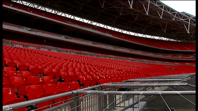 wembley stadium construction nears completion: stadium interior general views; shots of doors leading to tunnel seen from centre of football pitch;... - wembley stadium stock videos & royalty-free footage