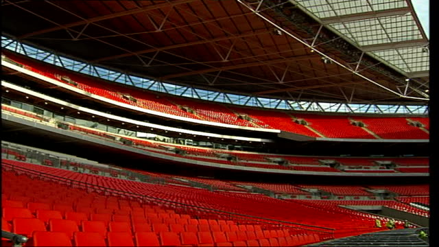 stockvideo's en b-roll-footage met construction will be finished for fa cup final muse to perform in june 2007 general view of stadium interior including seating and turf being laid - fa cup