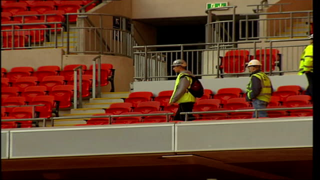 stockvideo's en b-roll-footage met construction will be finished for fa cup final muse to perform in june 2007 **michael cunnah interview partially overlaid** workmen wearing hard hats... - fa cup