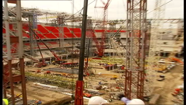 continued doubts over completion date; tx date unknown wembley: ext wembley stadium under construction pull out cms banner promoting the fa cup - wembley stadium stock videos & royalty-free footage