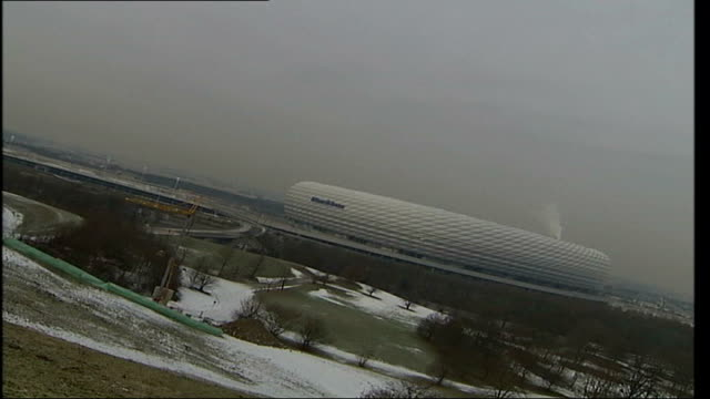 Continued speculation over completion date GERMANY Munich EXT Long shot of new Munich stadium ZOOM IN Close up tiles on stadium exterior PAN 'Allianz...