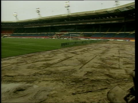 wembley stadium decision announced; lib wembley stadium: ext digger on pitch to area where turf has been removed sir geoff hurst lifting first piece... - turf stock videos & royalty-free footage