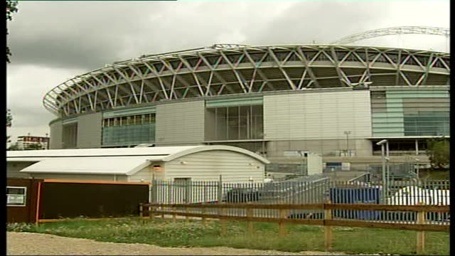 wembley stadium faces more delays; general view of wembley stadium under construction workers walking on roof of construction pull out high angle... - wembley stadium stock videos & royalty-free footage