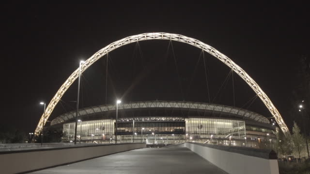 ws wembley stadium football arena w/ lighted arch unidentifiable people walking down ramp fg great britain united kingdom venues - wembley arena stock videos & royalty-free footage