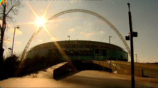 stockvideo's en b-roll-footage met wembley stadium gvs; england: london: wembley stadium: ext large 'the fa' sign and logo on side of wembley stadium/ general views of wembley stadium/... - english football association
