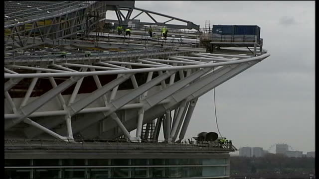 new doubts about re-opening date; r21020611 / 21.2.2006 construction workers on roof of webley stadium during contruction - wembley stadium stock videos & royalty-free footage