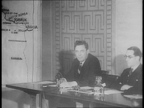 wendell willkie at press conference table, adjacent to oversize map of african front. - in front of点の映像素材/bロール