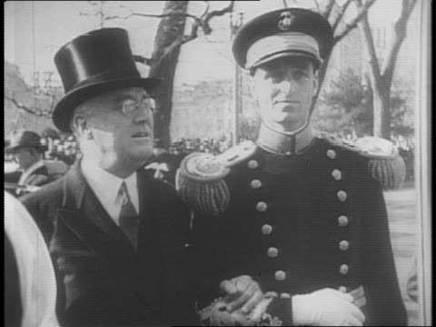 wendell willkie entering white house / meets and shakes hands with secretary of state cordell hull as reporters look on / exterior of white house /... - cordell hull stock videos and b-roll footage