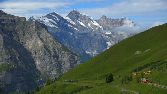 wengernalpbahn railway at kleine scheidegg, grindelwald, bernese alps, switzerland - bernese alps stock videos & royalty-free footage