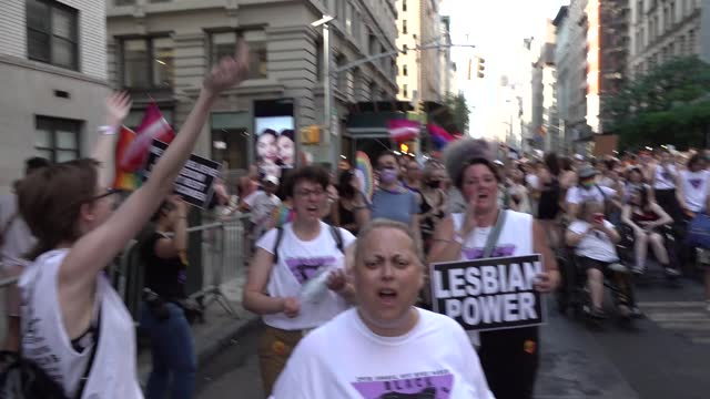"""we're here we're queer, we're fabulous don't f**k with us"""" is chanted during the 29th annual dyke march celebrating lgbtq pride protest on june 26,... - azul stock videos & royalty-free footage"""
