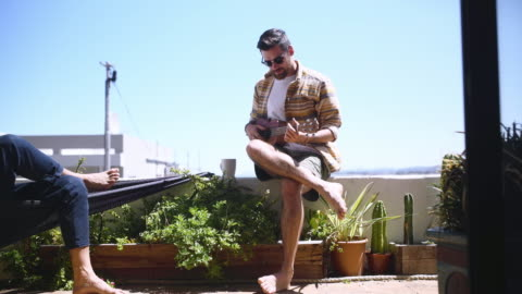 we're jamming the day away - balcony stock videos & royalty-free footage