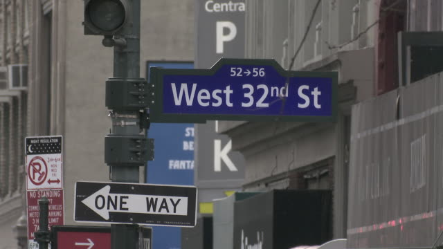west 32nd street sign in new york - no parking sign stock videos & royalty-free footage