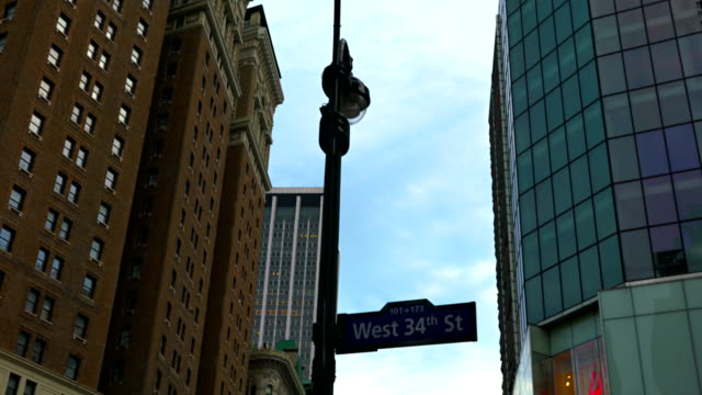 west 34th street sign