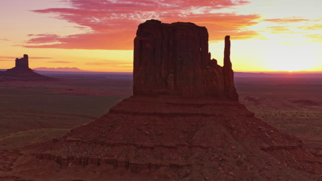 aerial west and east mitten butte at sunrise - mitten stock videos and b-roll footage