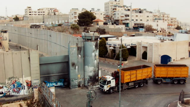 west bank barrier with watch tower seen from above in bethlehem, palestine. - palestinian territories stock videos and b-roll footage