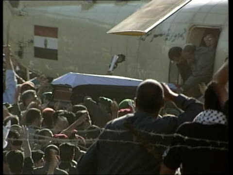 West Bank Ramallah EXT Coffin of former Palestinian President Yasser Arafat from helicopter and along through crowds gathered at his compound