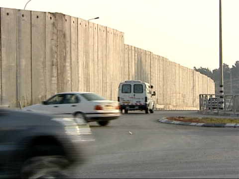 security wall in Nablus / street scenes in Ramallah ISRAEL West Bank Nablus EXT Various of concrete security wall dividing Israeli and Palestinian...