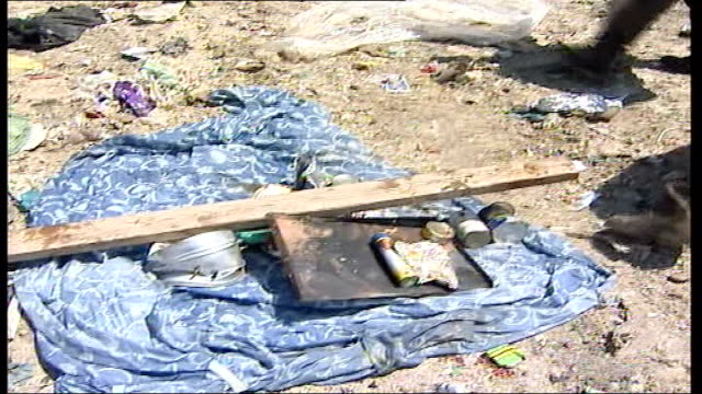 unemployed palestinians forced to scavenge for a living man puts plank of wood onto sheet with other salvaged material including tin cans and other... - sheet metal stock videos and b-roll footage