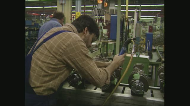 west berlin mercedes factory gvs west germany west berlin mercedes benz factory man operating lift equipment gv factory floor men checking parts - mercedes benz stock videos & royalty-free footage