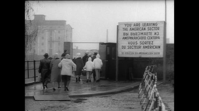 stockvideo's en b-roll-footage met west berliners lined up next to berlin wall waiting for annual holiday passage to east berlin / cars driving along rain soaked street at night /... - 1965