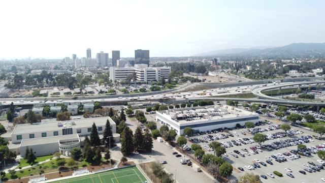 west la , brentwood, westwood, buildings, highway and residential area - westwood neighborhood los angeles stock videos & royalty-free footage