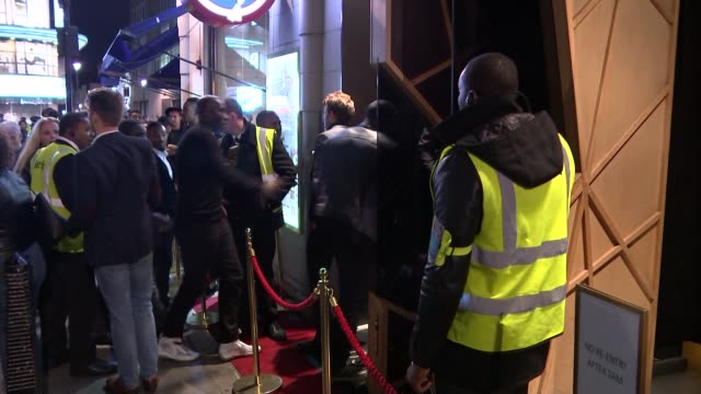 west end club accused of refusing women entry because of their colour; club employee coming out of club as reporter approaches him manager shuts the... - fototermin stock-videos und b-roll-filmmaterial