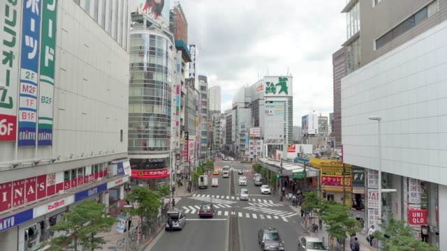 west exit of shinjuku station . shinjuku downtown area in tokyo , japan - west direction stock videos & royalty-free footage