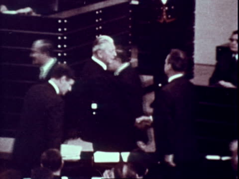 west german parliament in session, politicians applauding / newly-elected chancellor willy brandt shaking hands with out-going chancellor kurt georg... - 1969 stock-videos und b-roll-filmmaterial
