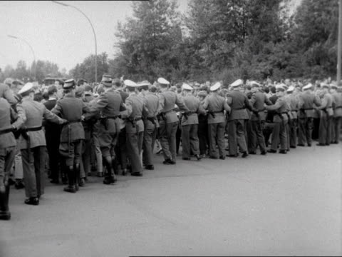 west german policemen push crowds back from near the brandenburg gate 15/08/61 - 1961 stock videos & royalty-free footage