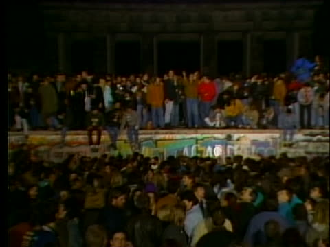 west germans gather at the brandenburg gate to celebrate the fall of the berlin wall. - 1989 stock videos & royalty-free footage