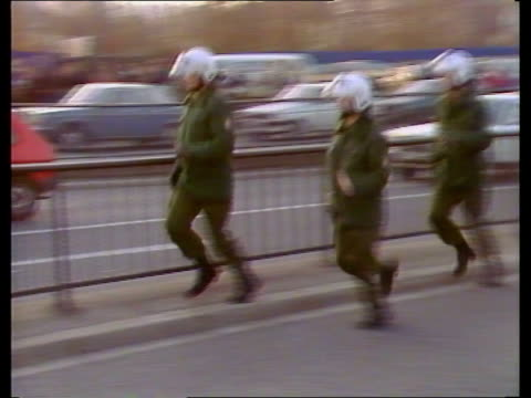 west germany bonn anti nuclear protestors blocking road zoom gv police convoy move up ms pan police on foot running bv police line up by protestors... - north rhine westphalia stock videos & royalty-free footage