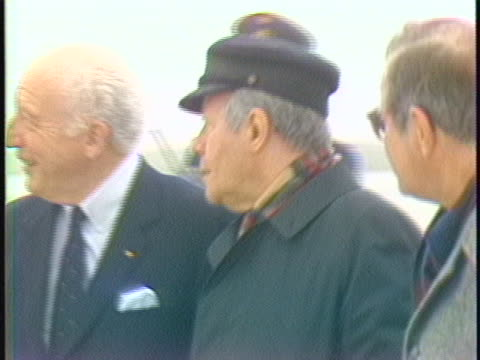 stockvideo's en b-roll-footage met west germany chancellor helmut schmidt walks with other across the tarmac after arriving in brussels germany for the upcoming european economic... - business or economy or employment and labor or financial market or finance or agriculture
