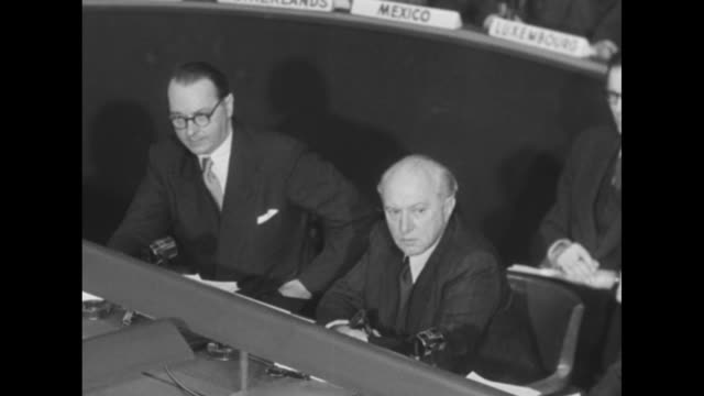west germany envoy heinrich von brentano seated at table speaking about free elections in berlin with another west german envoy sitting next to him /... - 1951 stock-videos und b-roll-filmmaterial