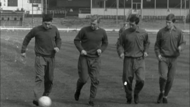 a look at the club's history LIB ENGLAND London Upton Park Boleyn Ground EXT B/W archive footage of West Ham footballers including Bobby Moore...