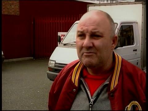 west ham manager harry redknapp resigns; vox pops sot - ハリー レッドナップ点の映像素材/bロール