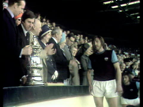 West Ham supporters cheer as Duke of Kent presents trophy to captain Frank Lampard Senior West Ham United vs Fulham 1975 FA Cup Final Wembley London