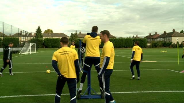 london ext west ham players training including coach teddy sheringham mark noble andy carroll and aaron cresswell - ウェストハム・ユナイテッドfc点の映像素材/bロール