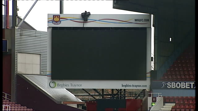 west ham united new owners photocall int david gold chatting with karren brady general views upton park with empty stands / blown up photographs of... - カレン ブラディ点の映像素材/bロール