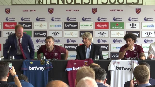 London London Stadium INT Manuel Pellegrini into press conference with Jack Wilshere and Felipe Anderson to pose for photocall with new shirts /...