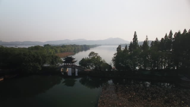 west lake from drone point of view, china - zhejiang province stock videos & royalty-free footage